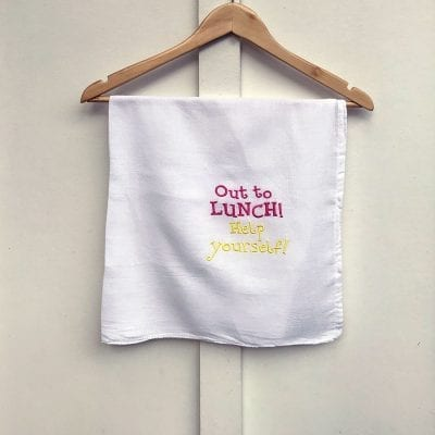 "custom dishtowel says ""Out to lunch, help yourself"""